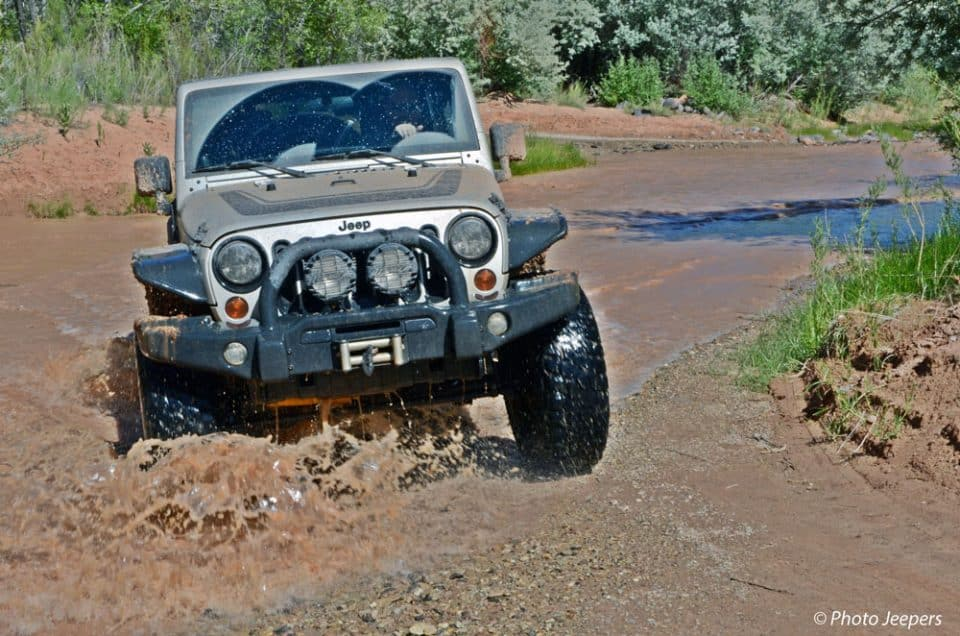 Jeep going through a muddy river