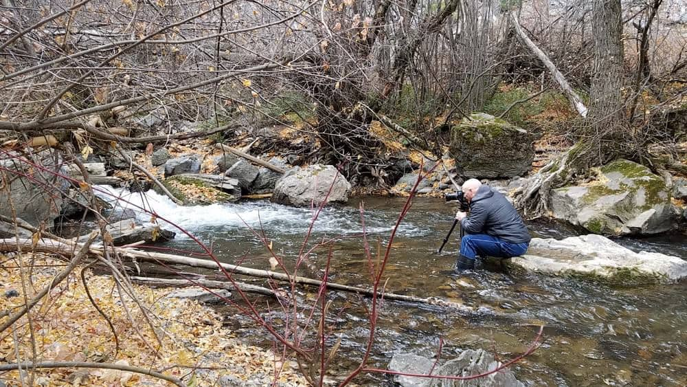 photographer in a river to take a picture