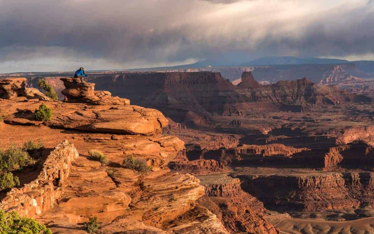 People enjoying the sunset at Dead Horse Point.