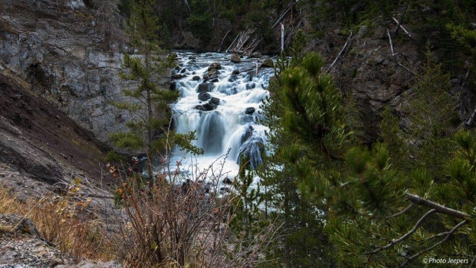 If you're anything like us, you LOVE seeing and photographing waterfalls. Here is our Yellowstone waterfall guide to help you find 7 beautiful waterfalls in Yellowstone National Park, USA. Don't forget to save this to your travel board!