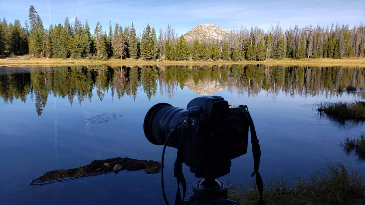 Use a tripod to reduce camera shake when photographing reflections.