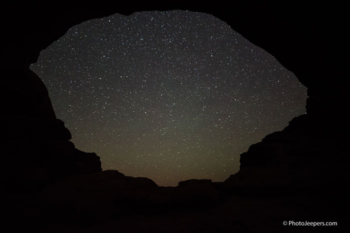 Arches National Park at night stars through the arch window