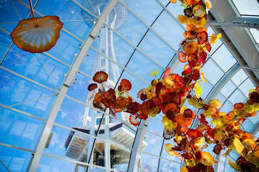 Chihuly Glasshouse sculpture with the Space Needle in Seattle, Washington