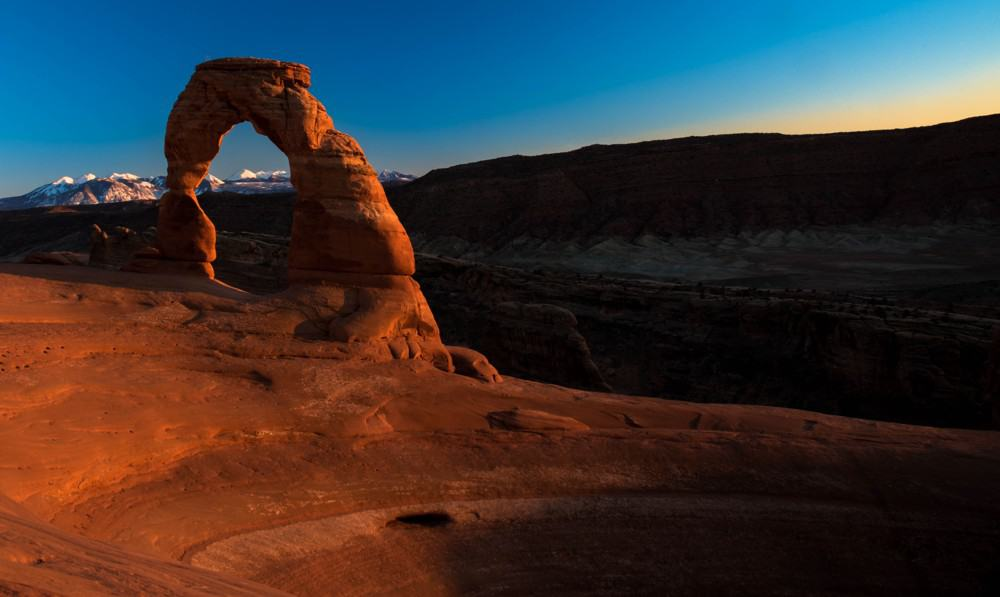Delicate Arch at sunset at Arches National Park in the winter.