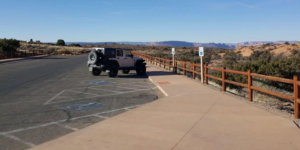 one jeep in the parking lot at Arches National Park in the winter