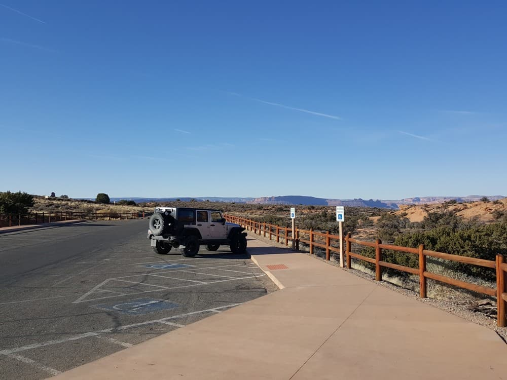 one jeep in the parking lot during the winter at Arches National Park