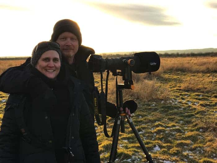 Dave and Jamie from Photo Jeepers standing by their tripod and camera while on a Bald Eagle Photography Tour