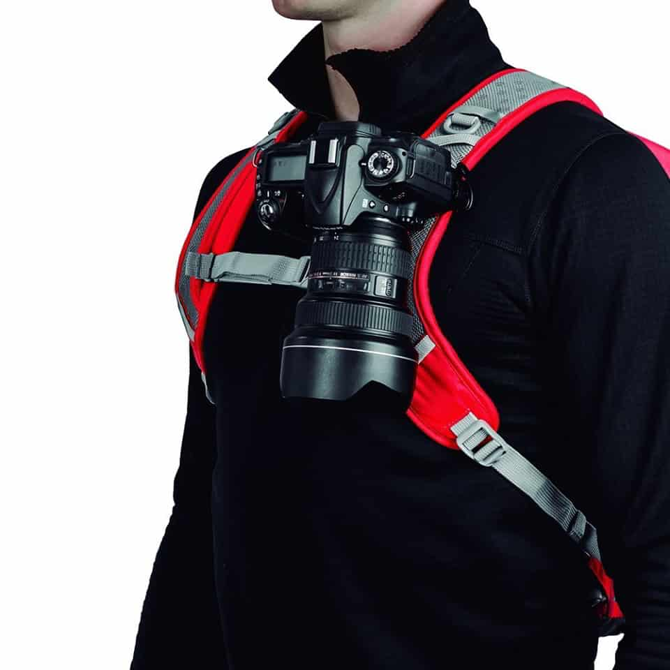 Camera gear for travel photography - Peak Design camera clip attached to a backpack strap