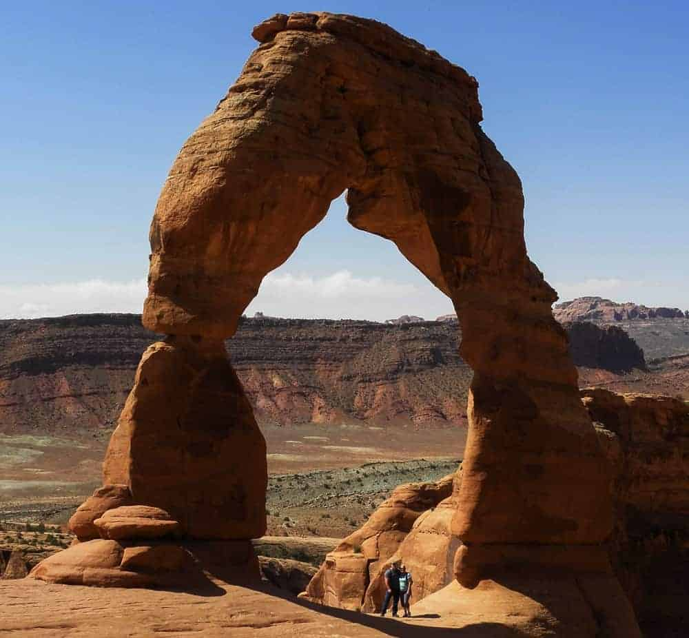 Photograph yourself with Delicate Arch so that people can see just how big this Arches National Park attraction really is!