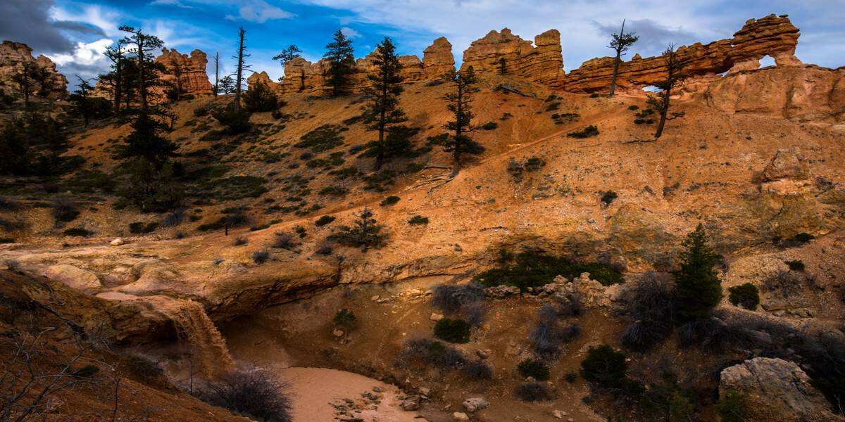 Muddy Tropic Ditch waterfall at Mossy Cave trail at Bryce Canyon.