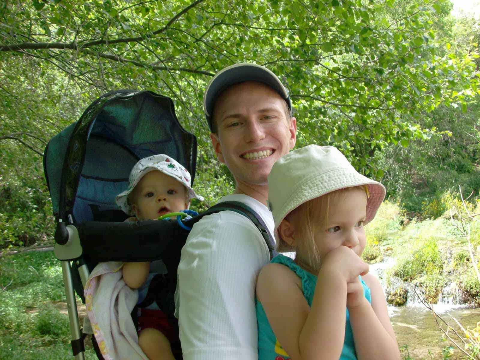 Wearing hats for sun protection is important when hiking with kids.