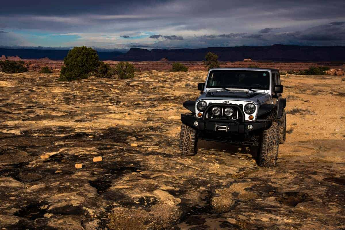 Jeep driving along an offroad trail at Canyonlands Needles.