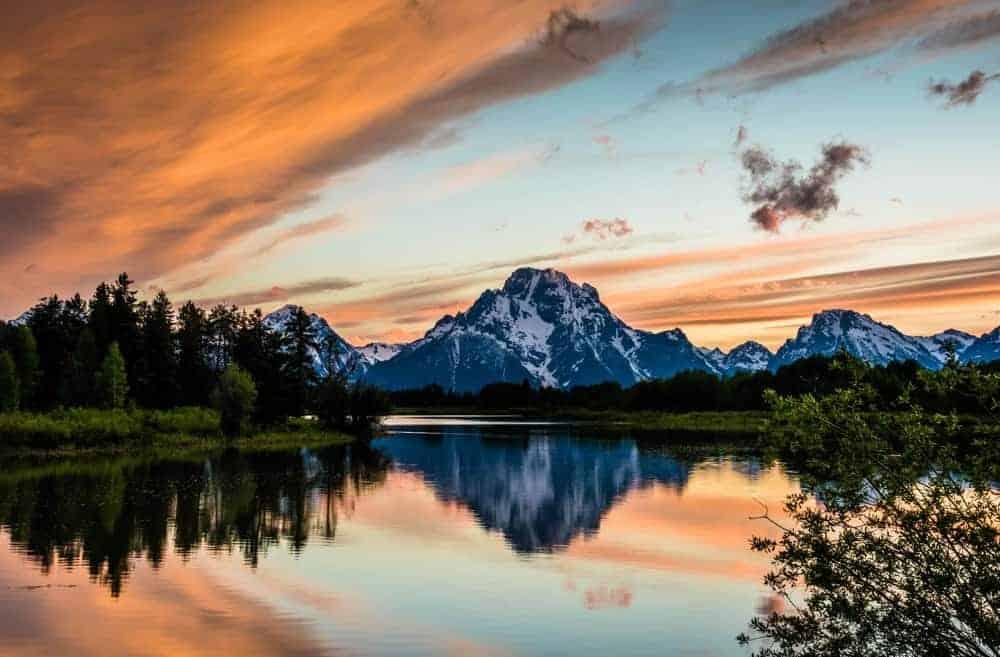 Sunset at Oxbow Bend at Grand Teton National Park with a colorful sky.