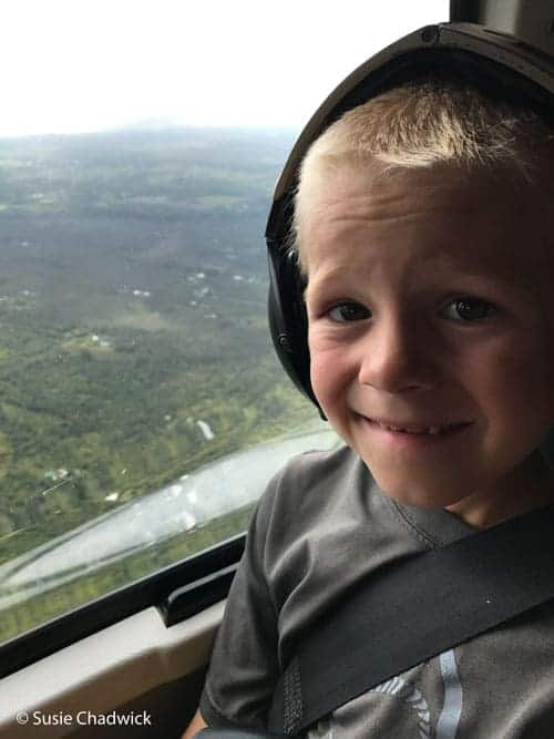 Boy in a helicopter - Big Island of Hawaii with kids