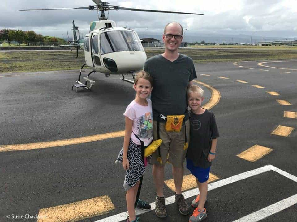 Dad and two kids doing a helicopter tour - Big Island of Hawaii with kids