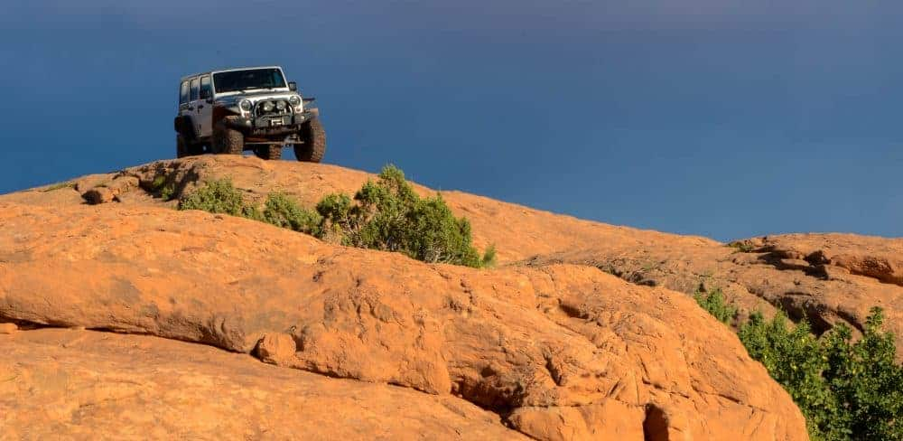 Jeep atop slickrock in Moab, Utah.
