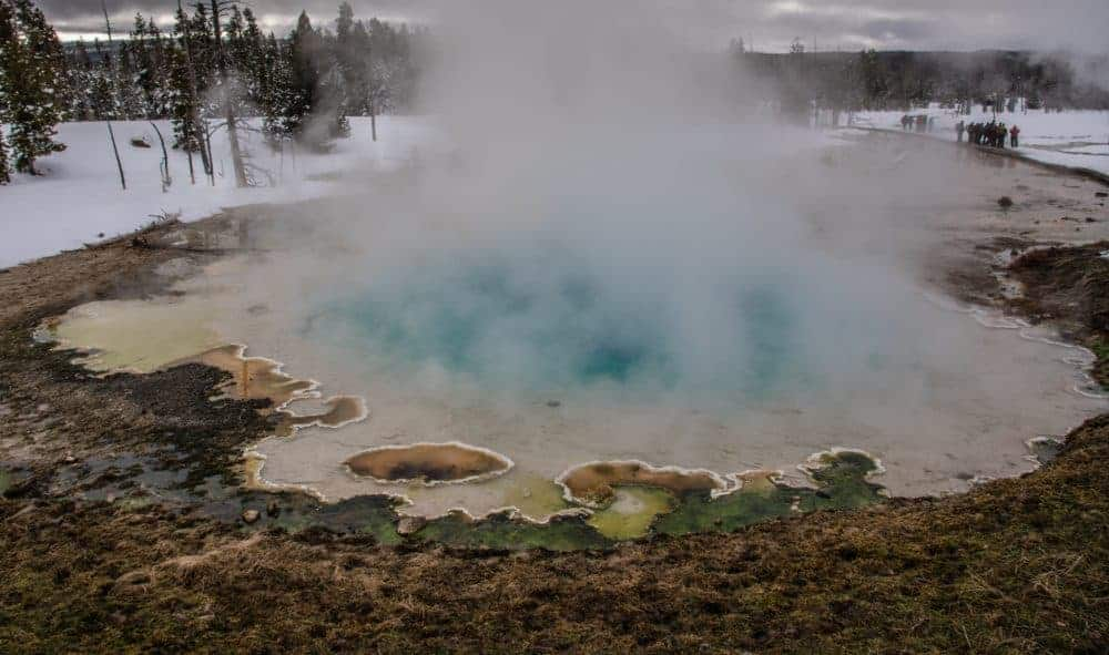 Steaming geyser at Yellowstone National Park in the winter.