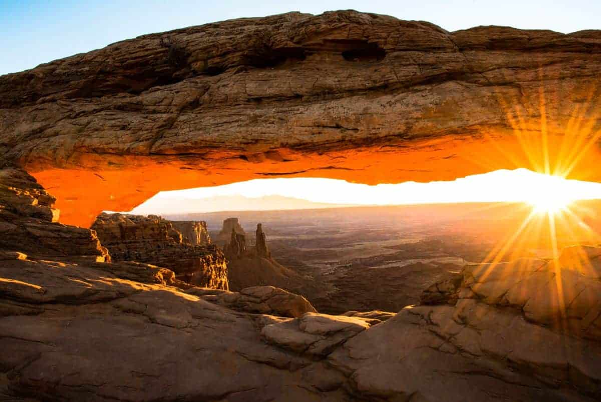 Watch the sunrise at Canyonlands near Moab, Utah.
