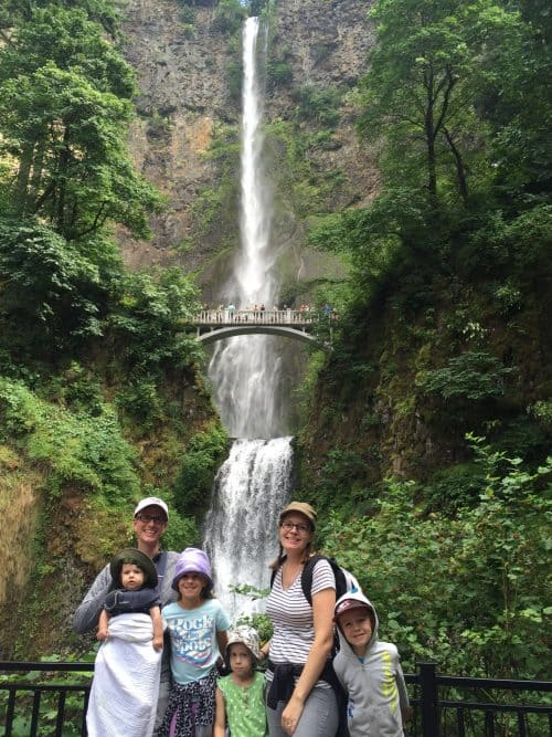 A family posing in front of Multnomah Falls near Portland, Oregon