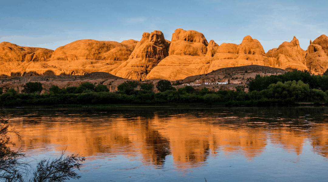 Reflection of the red rocks in Moab, Utah at sunset in the Colorado River.