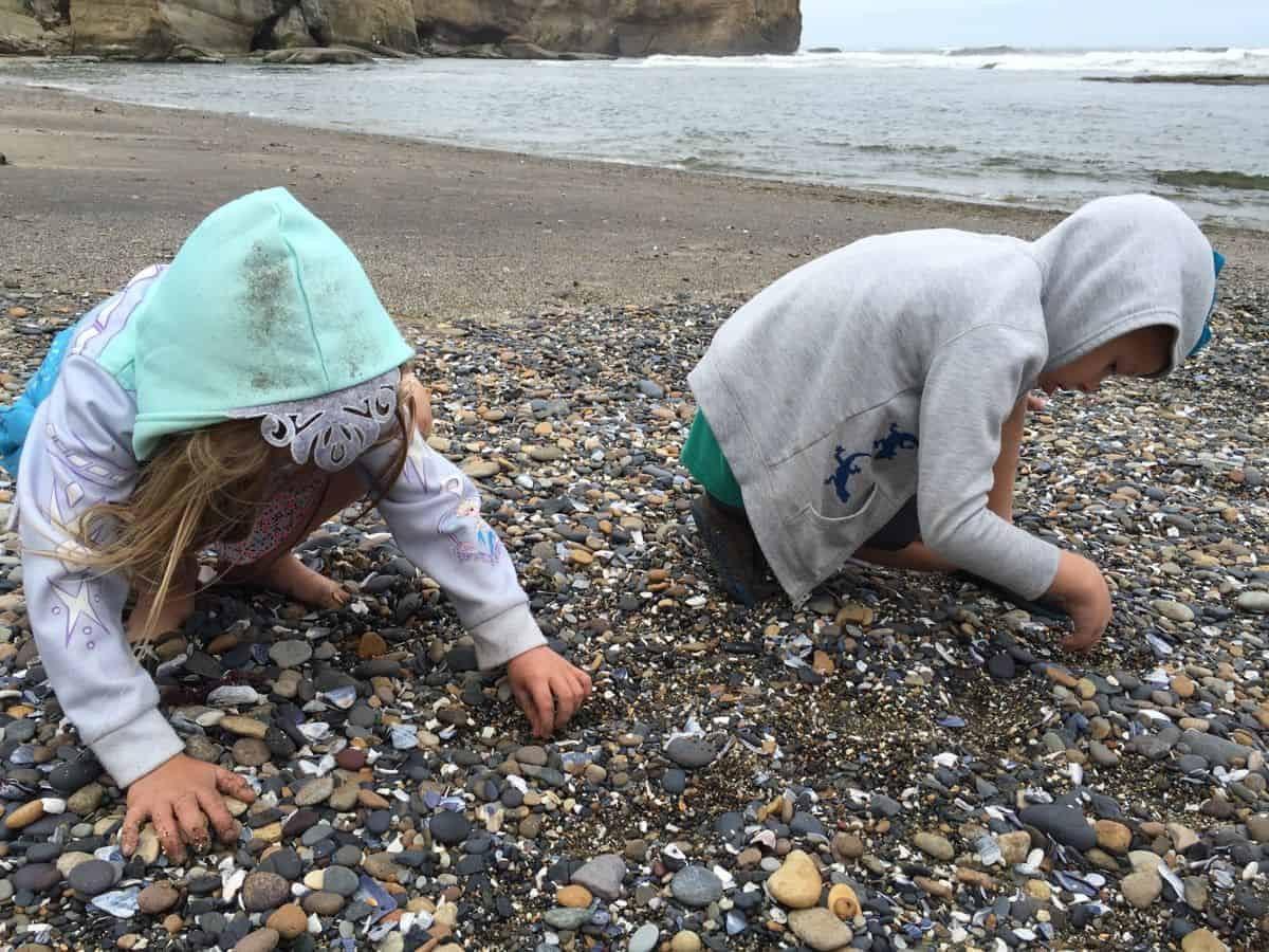 Searching for sea glass at Otter Rock beach in Oregon is a fun activity for kids.