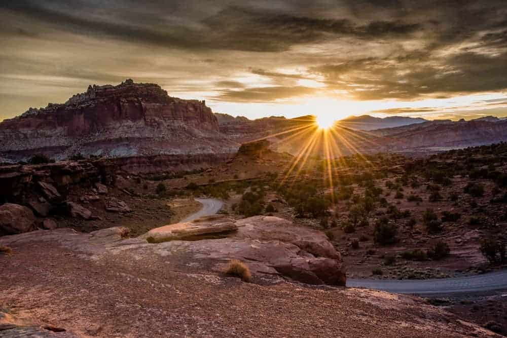 Photographing the sun as it rises over the horizon at Capitol Reef National Park.