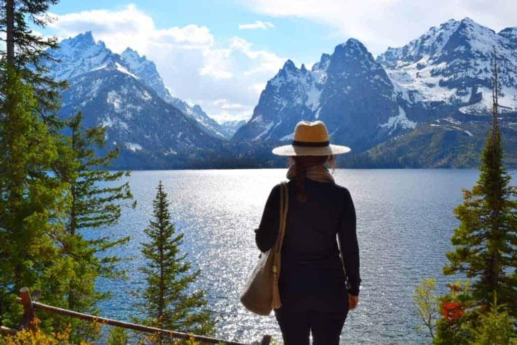 Woman looking at Jenny Lake at Grand Teton National Park - US National Park List: 25 Beautiful Parks to Visit