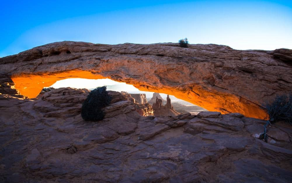 Sunrise Photography: Tips to Get Beautiful Sunrise Photos - Mesa Arch at sunrise at Canyonlands National Park, Utah