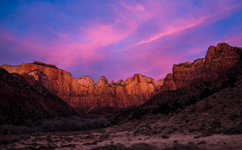 Sunrise Photography: Tips to Get Beautiful Sunrise Photos - blue hour sunrise at Zion National Park results in a blue sky with pink clouds