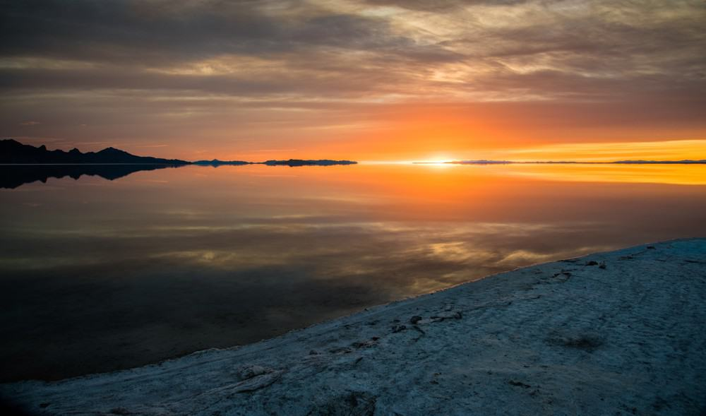 Sunrise Photography: Tips to Get Beautiful Sunrise Photos - golden sunrise at Bonneville Salt Flats, Utah