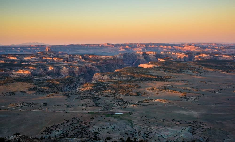 Sunrise Photography: Tips to Get Beautiful Sunrise Photos - golden sunrise at San Rafael Swell, Utah