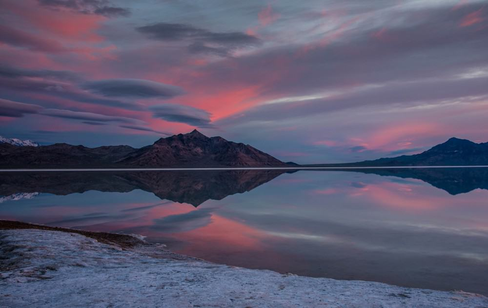 Sunrise Photography: Tips to Get Beautiful Sunrise Photos - sunrise with pink clouds at Bonneville Salt Flats in Utah