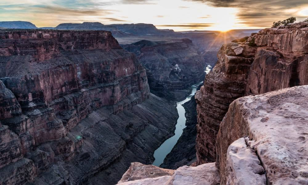 Grand Canyon Tuweep at sunset with the Colorado River at the bottom of the canyon.
