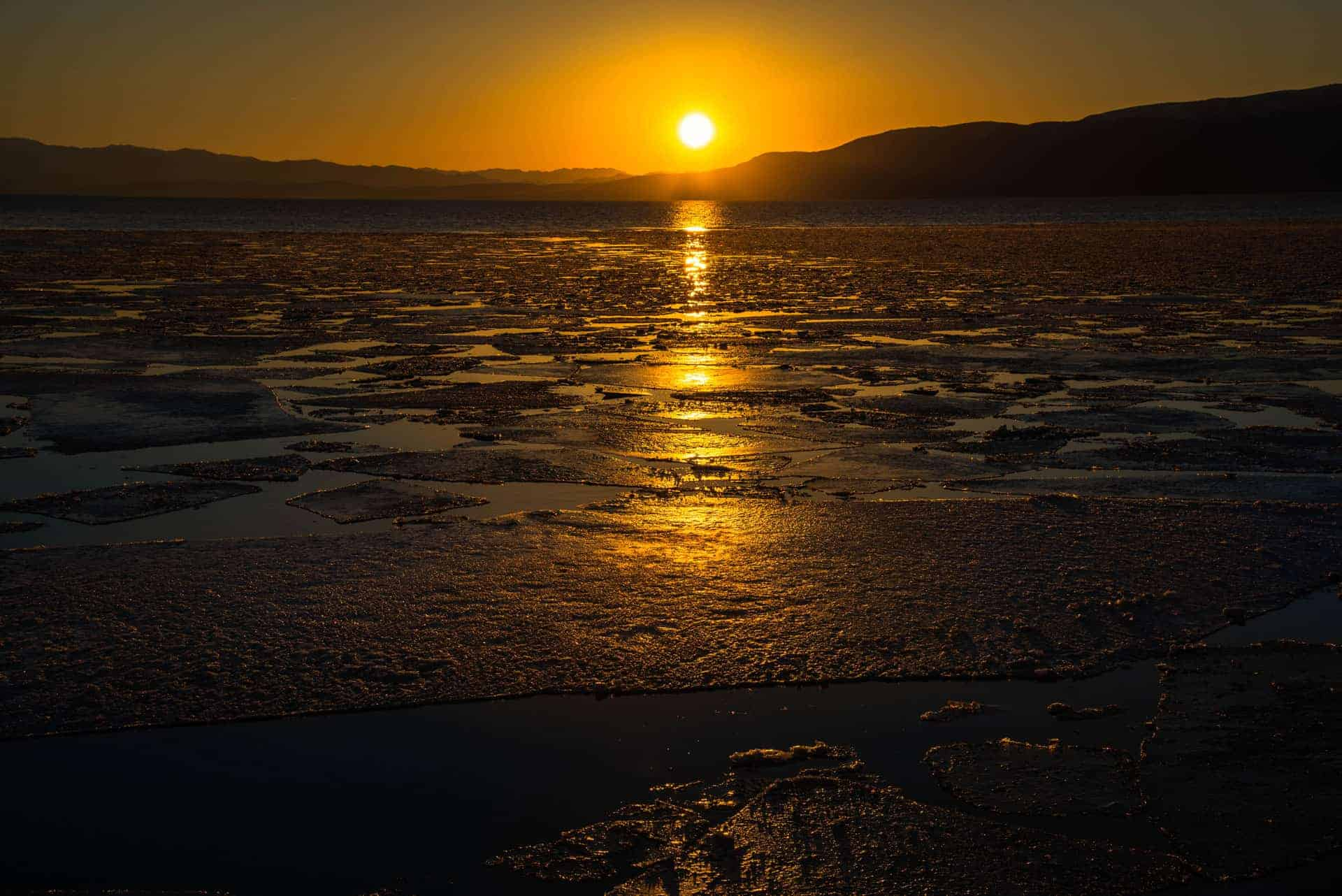 Utah Lake at sunset with floating sheets of ice