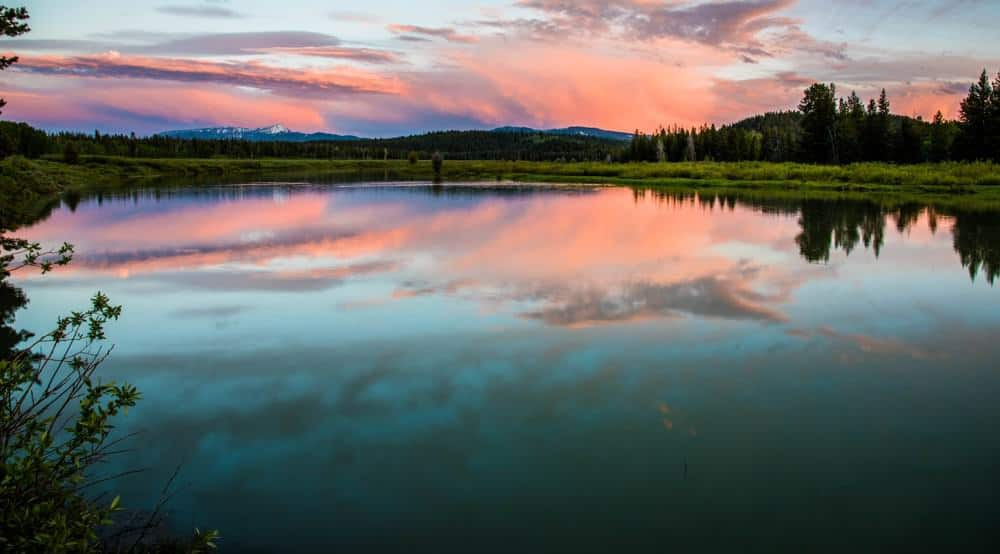 colorful clouds at sunset reflecting into the Snake River at Oxbow Bend at Grand Teton National Park