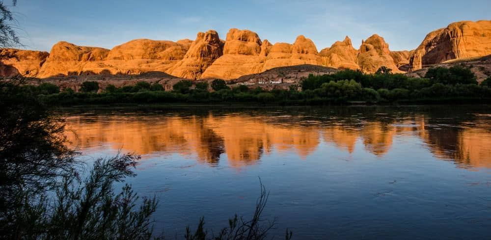 Reflection of red rocks in the Colorado River near Moab, Utah at sunset
