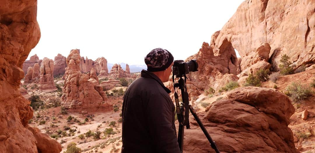 Photographer with tripod at Arches National Park