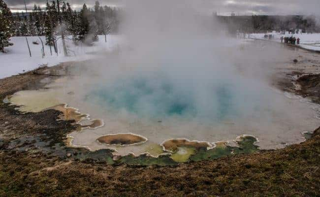 colorful hot pool at Yellowstone in the winter