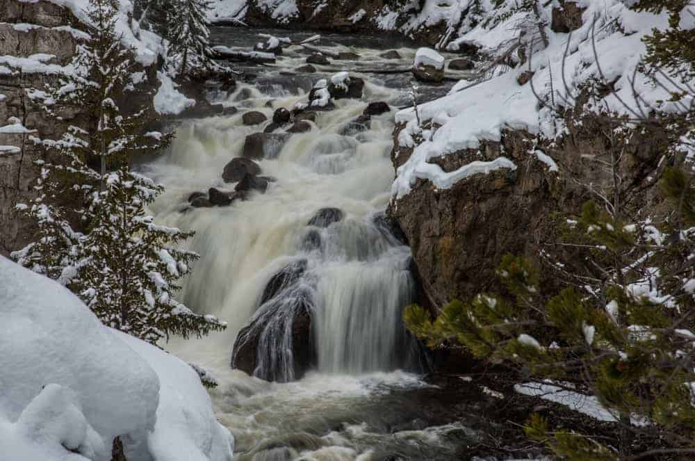 Firehole Falls waterfall in the winter at Yellowstone National Park