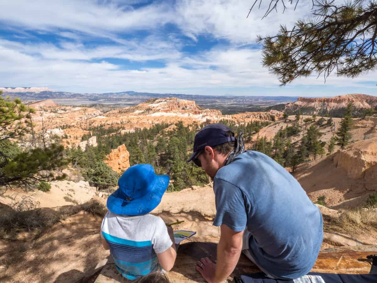 Dad and son overlooking Bryce Canyon National Park: National Parks with kids