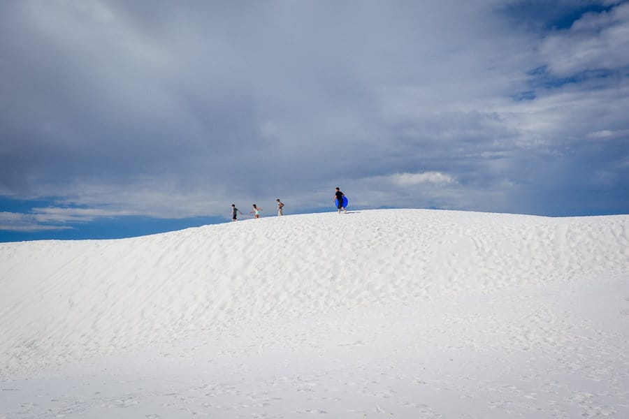 Kids sledding at White Sands National Monument: National Parks with kids