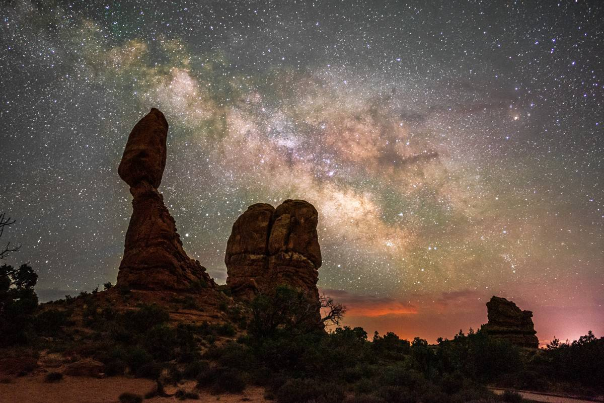 Milky way over Balanced Rock at Arches National Park, Utah.