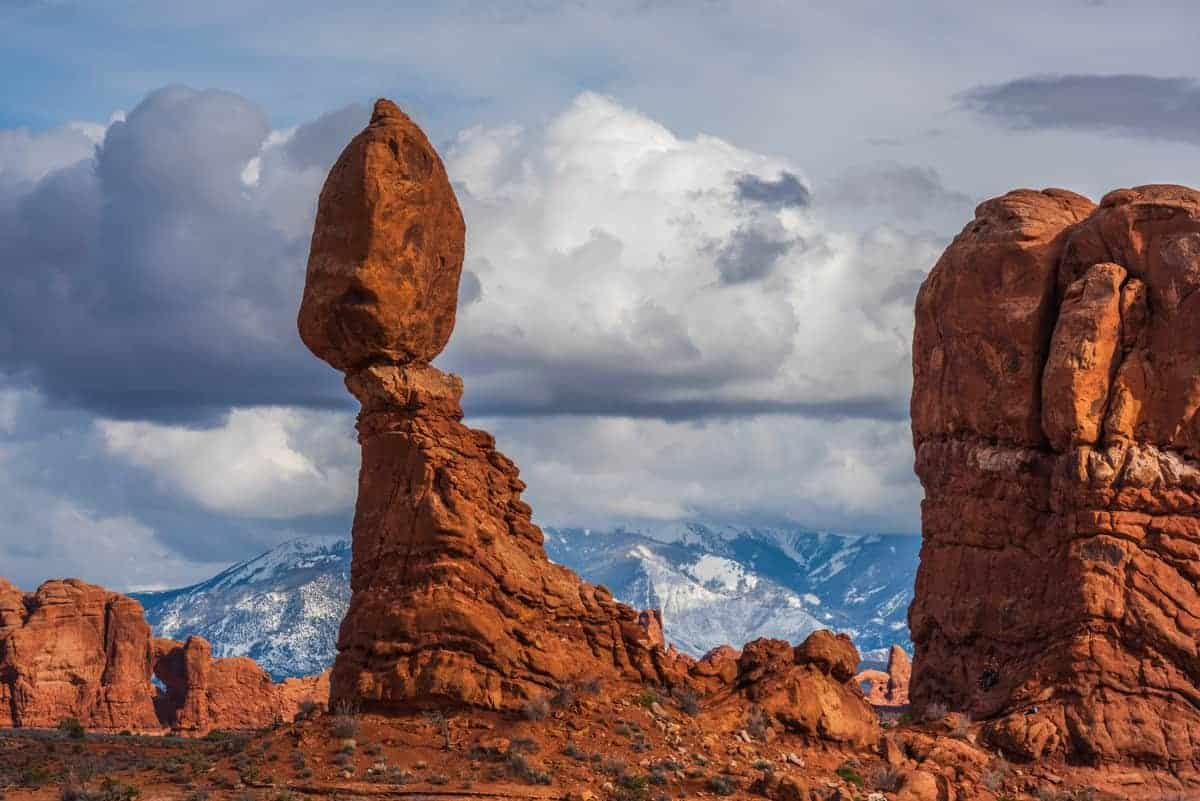 Balanced Rock with snowy La Sal mountains in the background.