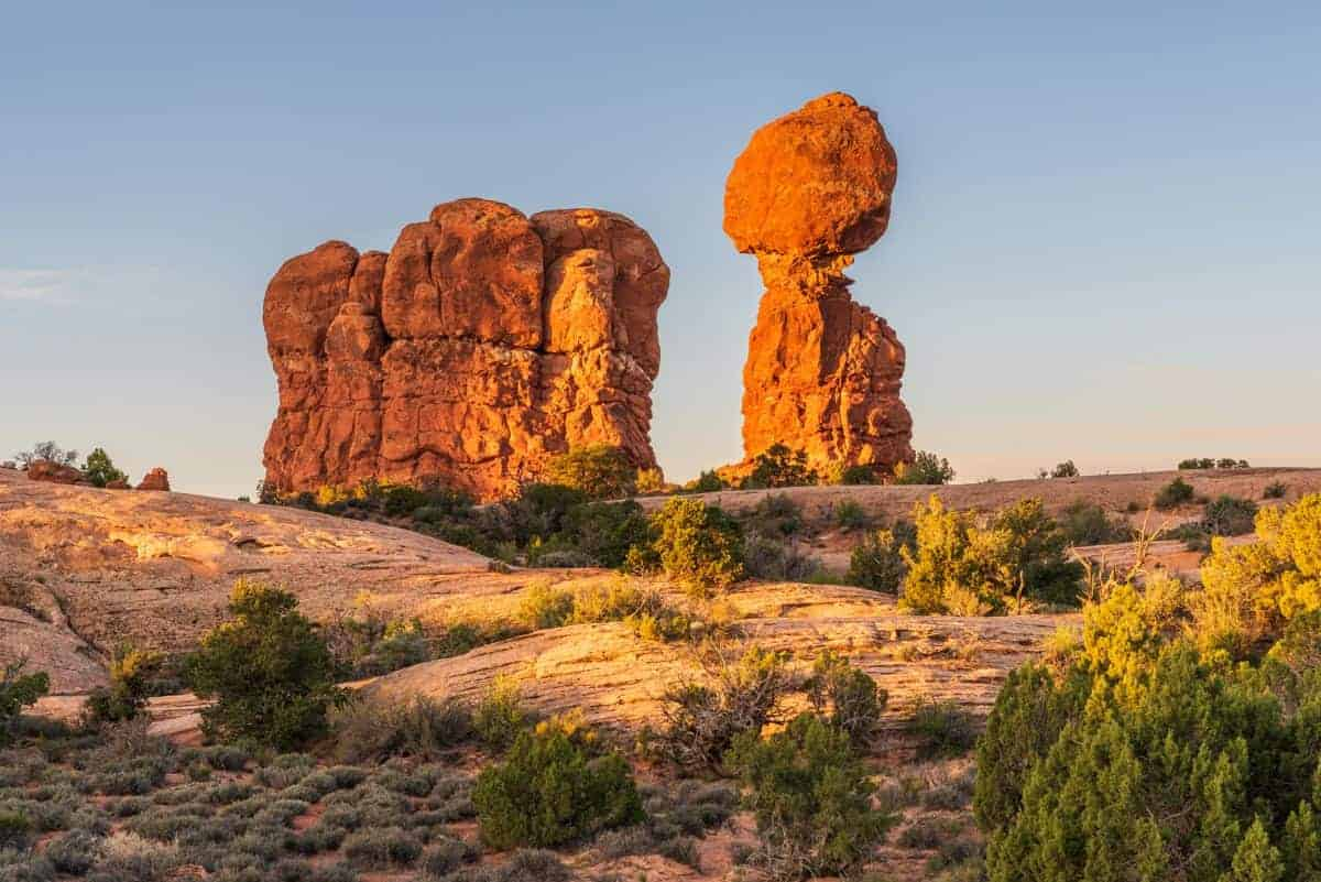 Sunset is a good time to photograph Balanced Rock at Arches National Park.