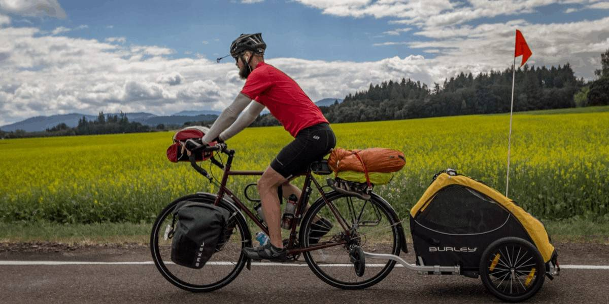Man riding his bike with a kid carrier in the Willamette Valley of Oregon