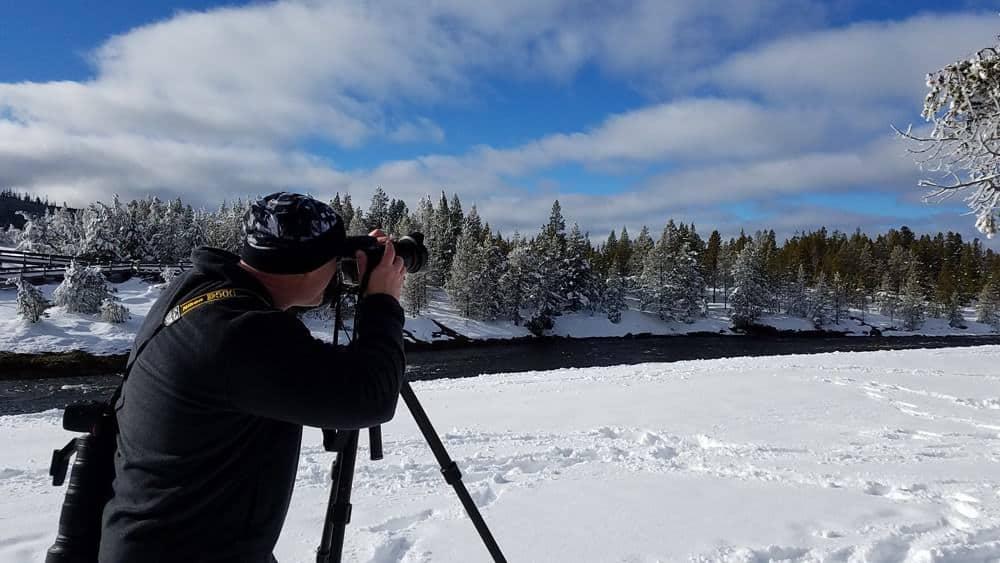 photographer at Yellowstone in the winter.