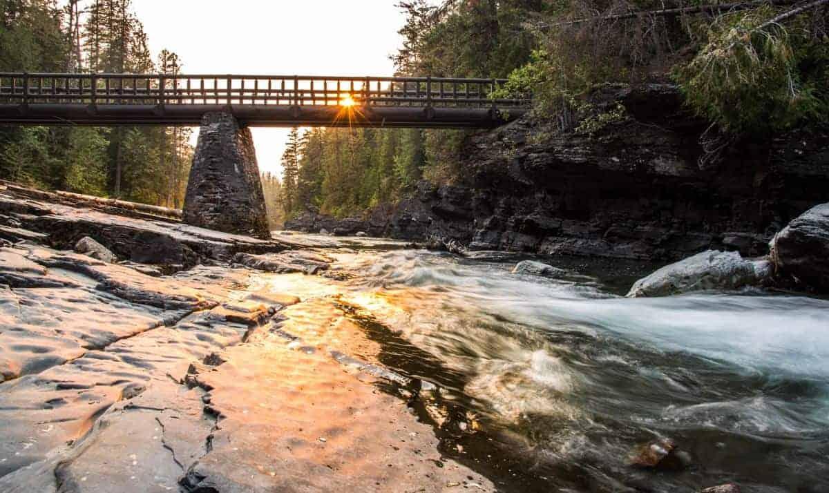Bridge over McDonald River at Glacier National Park at sunset.