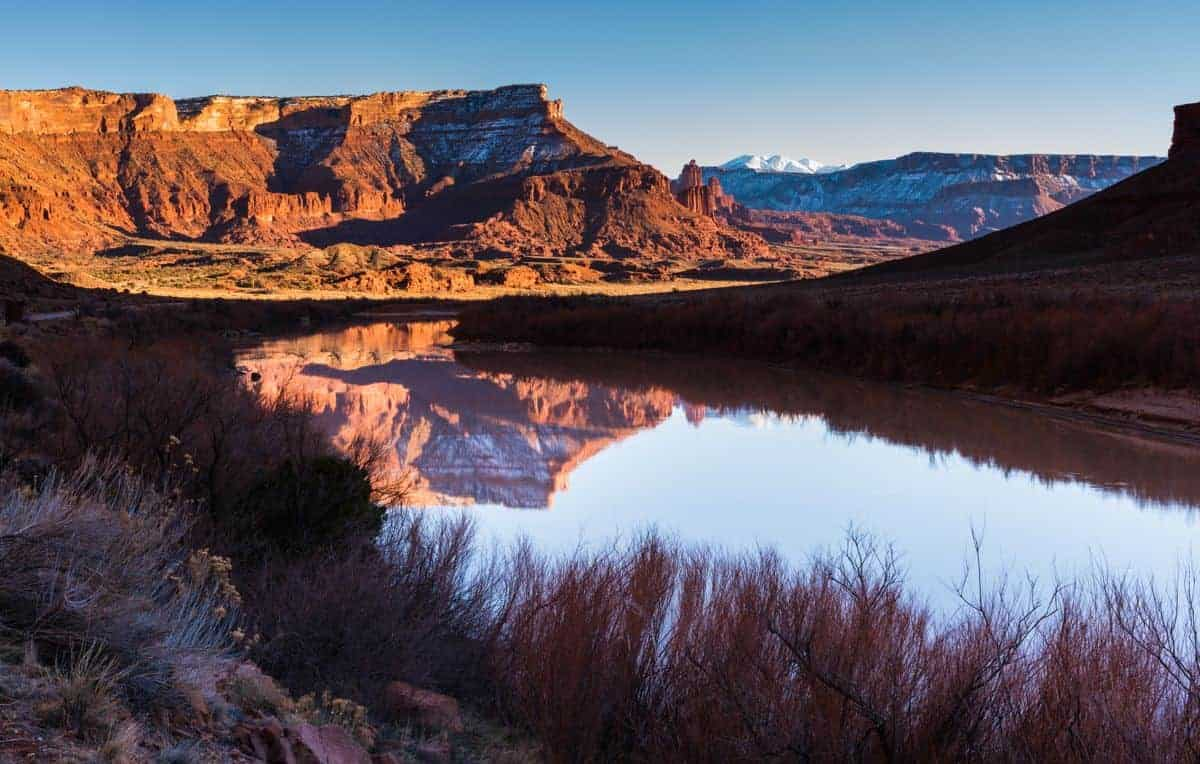Fisher Towers reflected in the river near Moab, Utah.