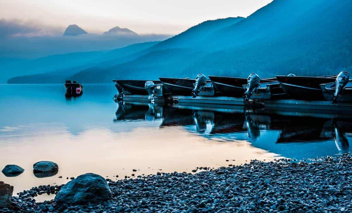 A row of boats at McDonald Lake in Glacier National Park.
