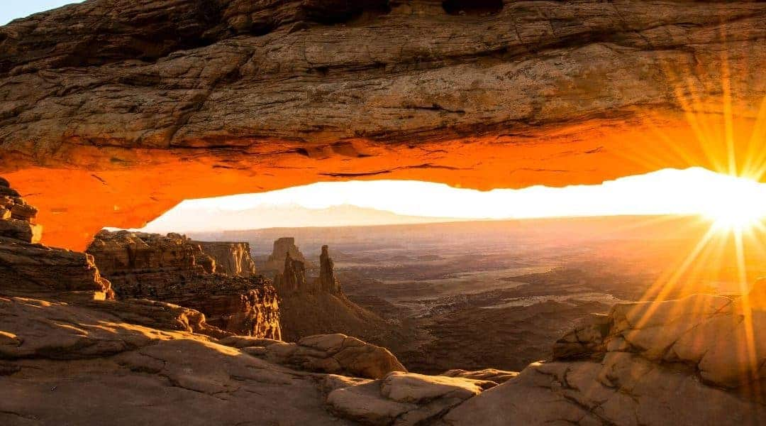 watch the sunrise at Mesa Arch when visiting Canyonlands Island in the Sky